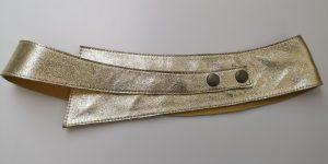 Asymetrisk guld bælte