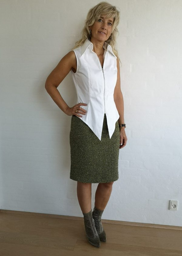 Grøn nederdel i sildebensmønster